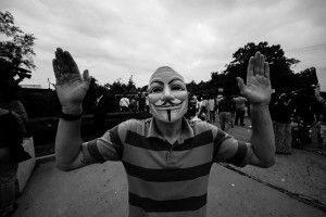 "Anonymous ""Hands Up, Don't Shoot"" protester in Ferguson, MO."