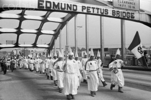 Ku Klux Klan march across Edmund Pettus Bridge in Selma, AL