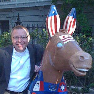 Tim Corrimal posing with a D.C. Democrat