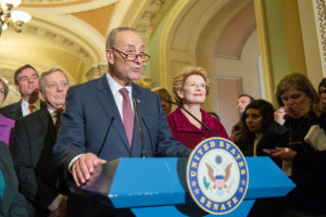 Senate Minority Leader Chuck Schumer flanked by fellow Democratic Senators